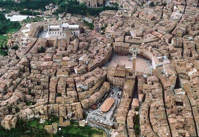 An aerial view of Siena which shows the narrow streets and the large piazza