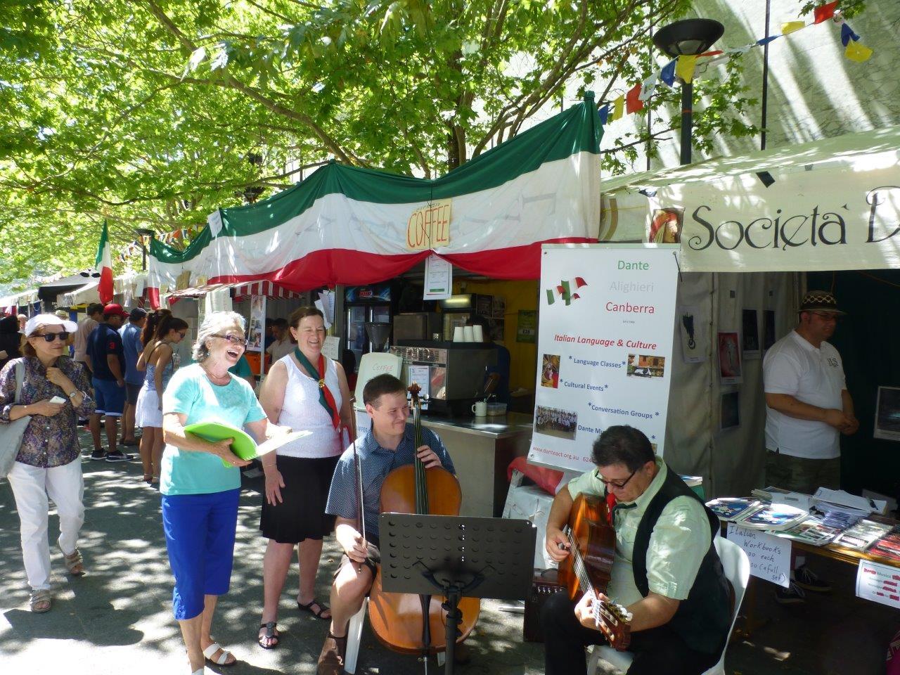 Yvette, Margaret, Matthew and Rod provide some entertainment outside the Dante stall